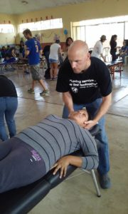 A chiropractor adjusting a patient.
