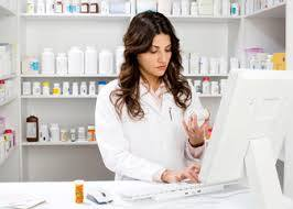 pharmacist looking up information on medications