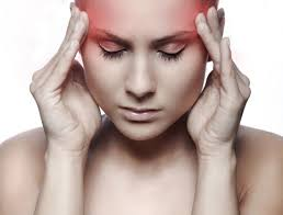 picture of a woman with a headache